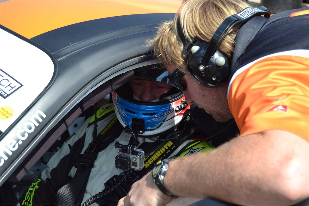 ENGINEER DISCUSSING STRATEGY WITH DRIVER