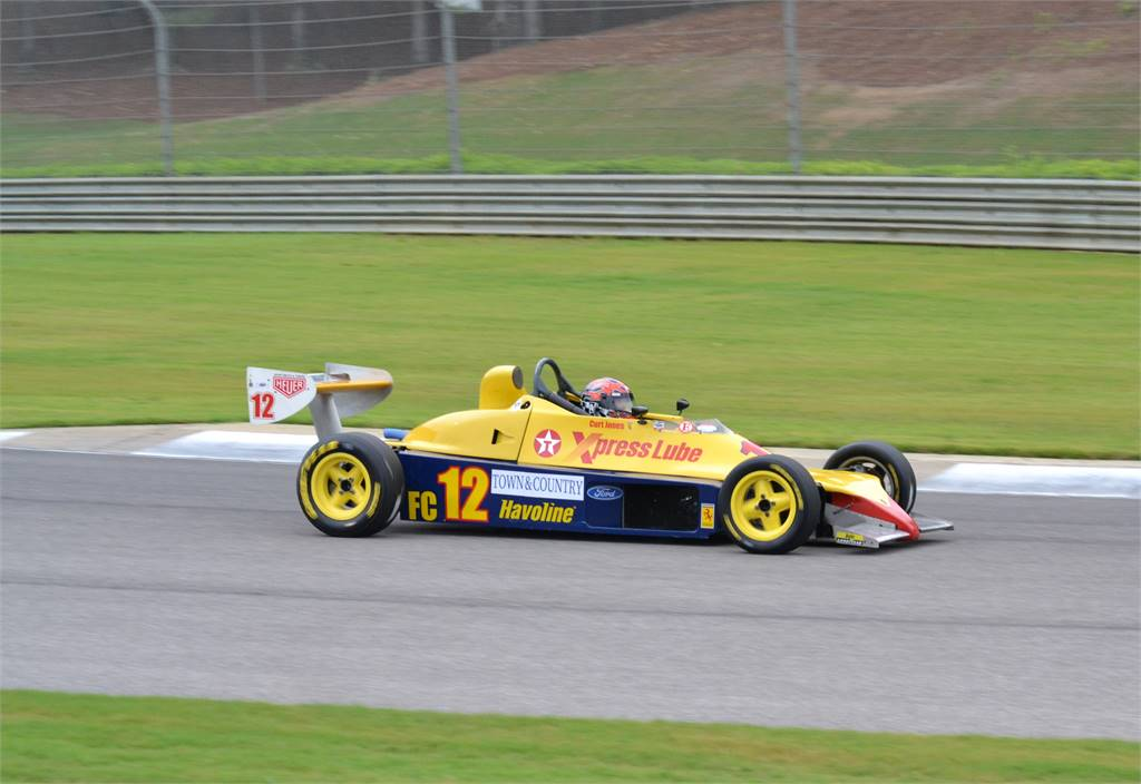 EXPRESS OIL FORMULA TYPE CAR ON TRACK